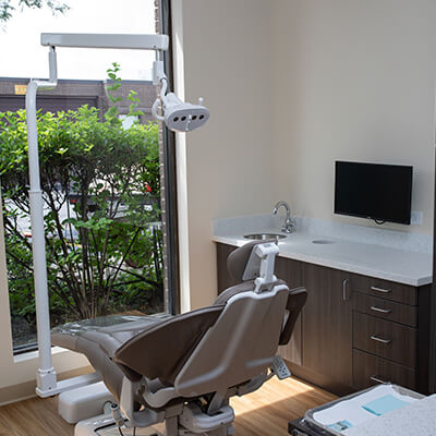 Our dental treatment room with a dentist chair and modern equipment