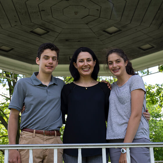 Our Lake Bluff Family Dentistry owner outside with her two children while they all smile