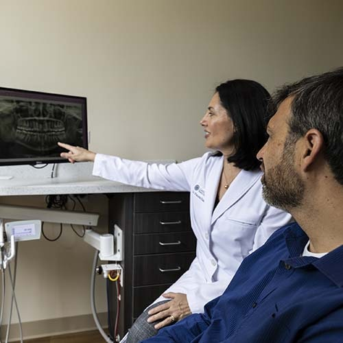Dr. Khan giving a second opinion to a patient